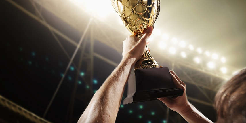 Athlete holding up a trophy that was designed through a product configurator