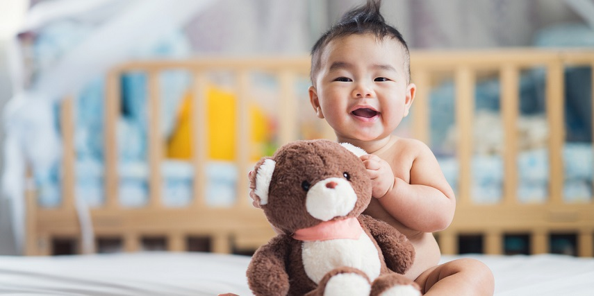 Baby hugging a custom teddy bear made with a product customizer