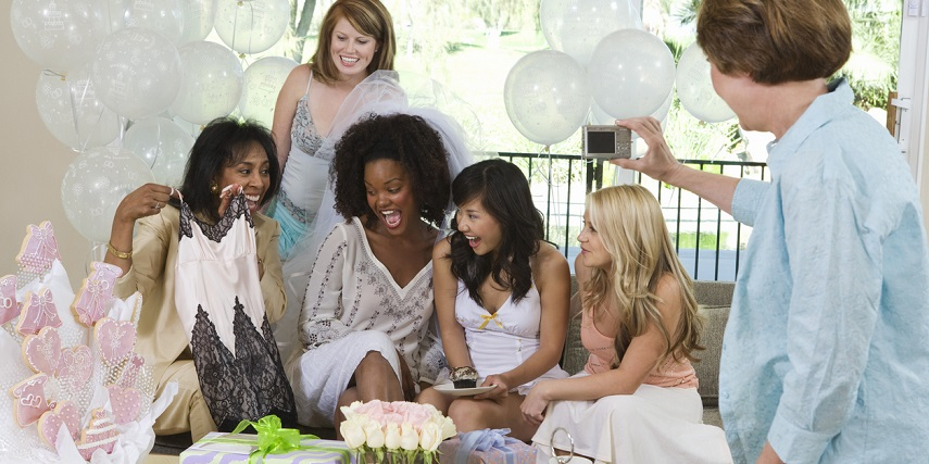 Bride opening customized gifts at a bridal shower