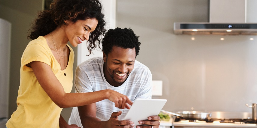 Couple looking at furniture online through a product configurator