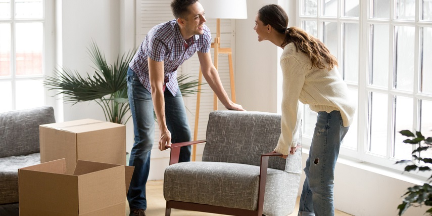 Couple moving a chair they purchased through AR for eCommerce