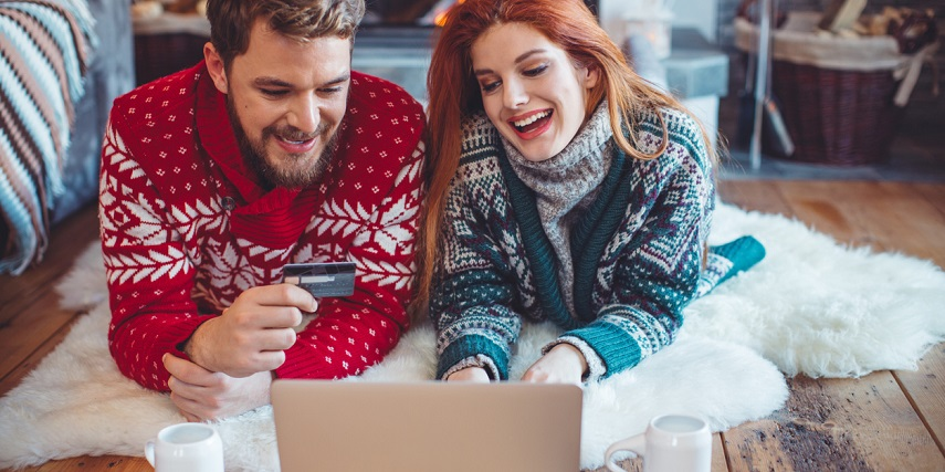Couple using product customization tools to shop for holiday gifts