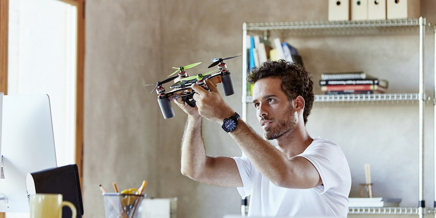 Customer holding an octocopter he made in a drone configurator