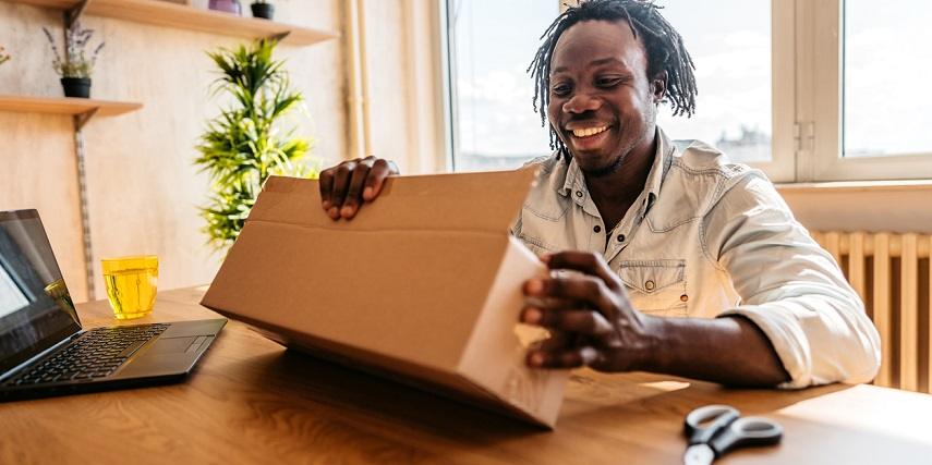 Customer receiving a custom package and marketing inserts after ordering through a WooCommerce product configurator