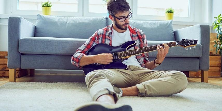 Customer testing out a new guitar built through a guitar configurator