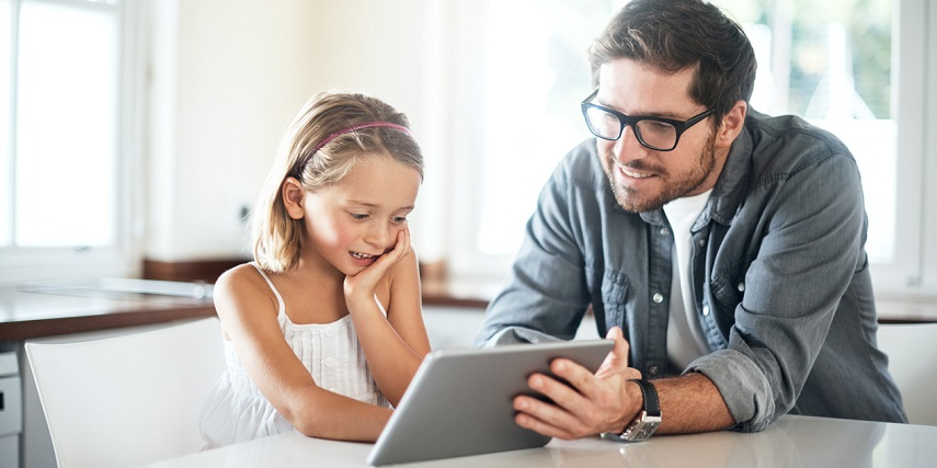 Father and daughter playing with an augmented reality in eCommerce tool on their tablet