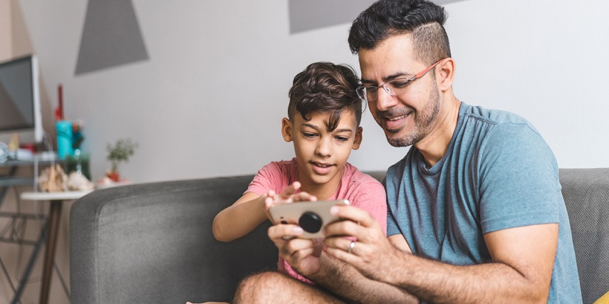 Father and son shopping for clothes online through an apparel configurator