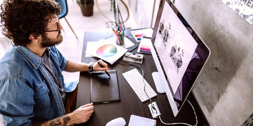 Graphic designer creating unique designs for sublimination printer-made products