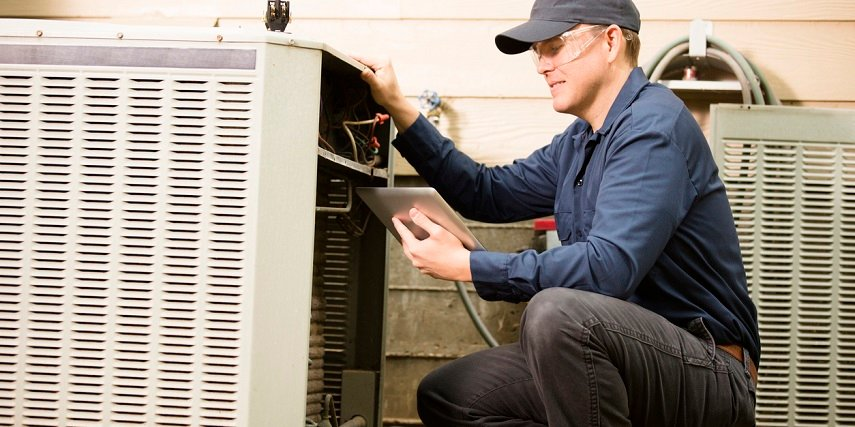 HVAC repair technician using a product customizer to order replacement parts