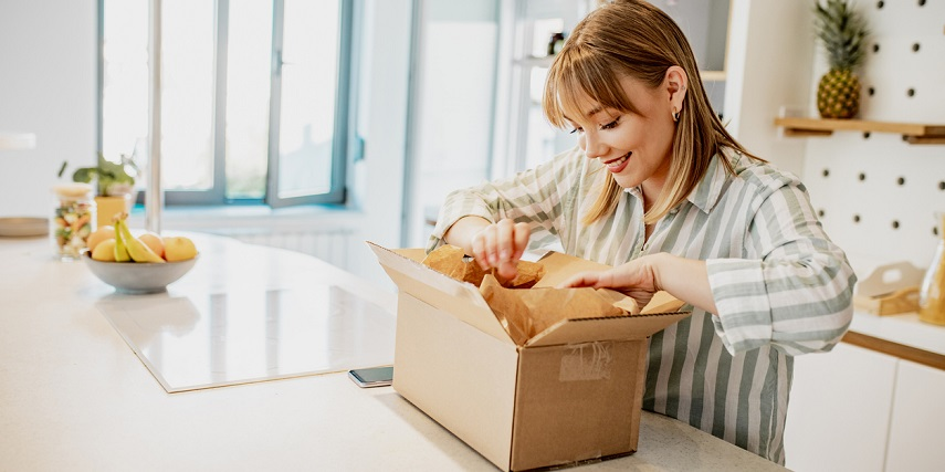 Happy shopper receiving their product in the mail