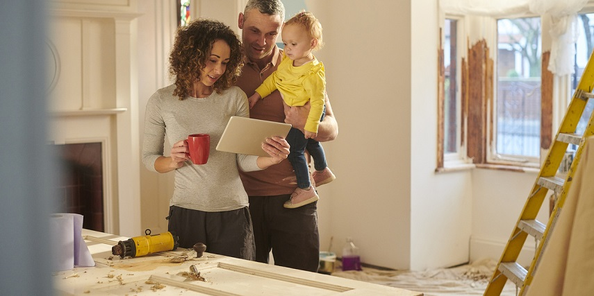 Homeowners browsing remodeling options in a 3D house configurator