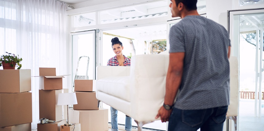 Homeowners moving the new couch they designed through a couch configurator