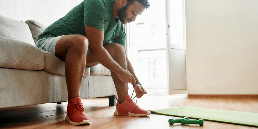 Man putting on custom sneakers made in a sneaker configurator