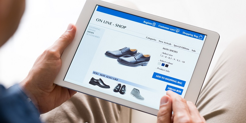 Man shopping for shoes in an online store