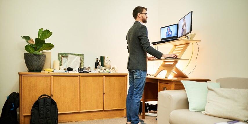 Man working at a standing desk he bought through a 3D customizer