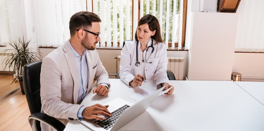 Medical professional and salesperson looking at options in a visual configurator