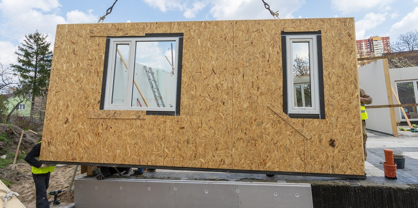 Modular building wall being assembled on-site