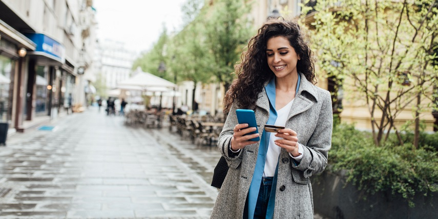 Shopper buying custom formalwear through an apparel configurator on her phone