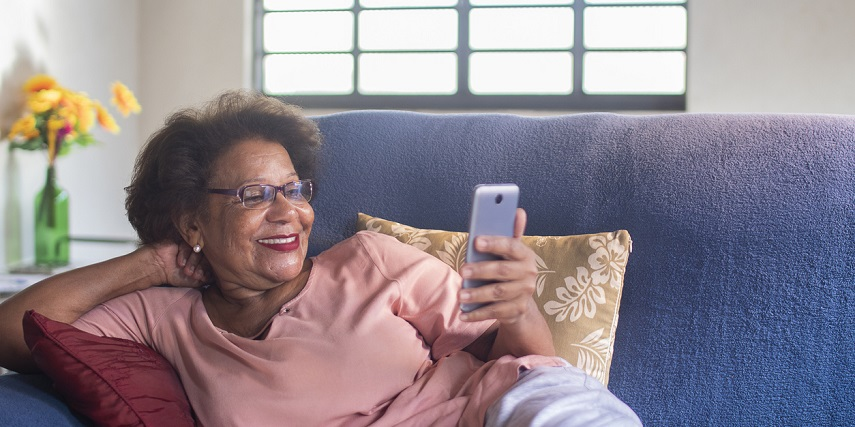 Shopper looking at AR furniture through a product configurator on her phone