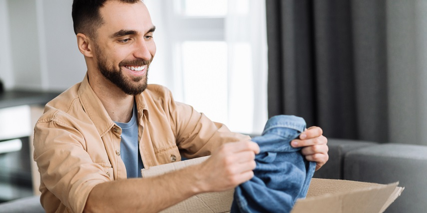 Shopper looking at a denim jacket he personalized in an apparel configurator