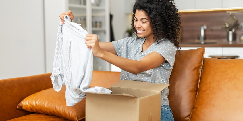 Shopper opening a package to a custom shirt she saw virtual photography images of online