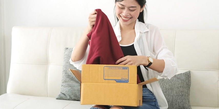 Shopper receiving a custom sweater she made in an apparel configurator