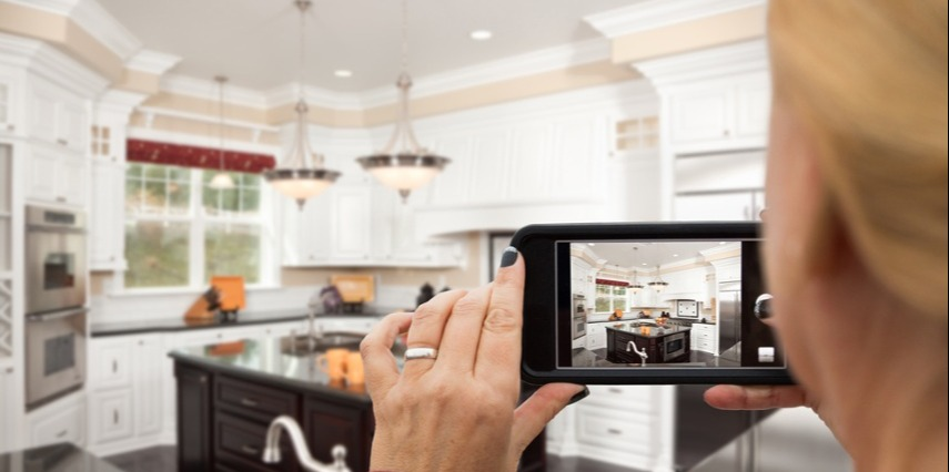 Shopper using AR for eCommerce to see virtual kitchen items in her home