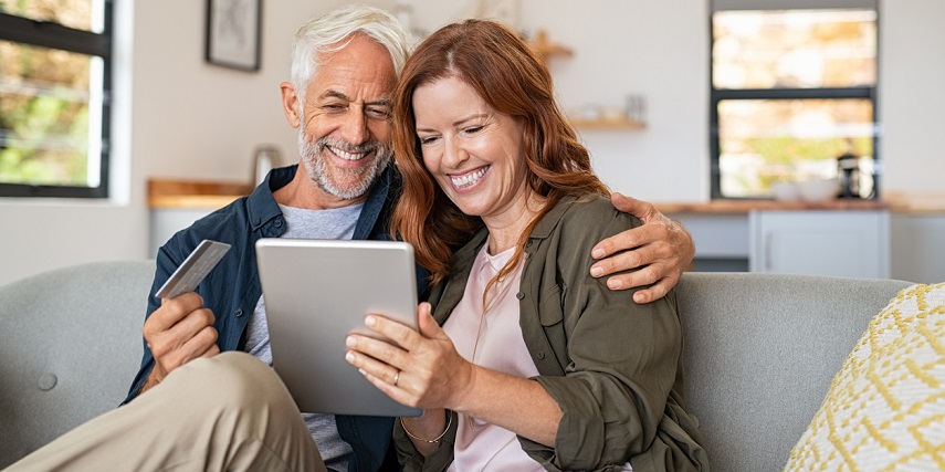 Shopping couple having fun with an online product configurator at home
