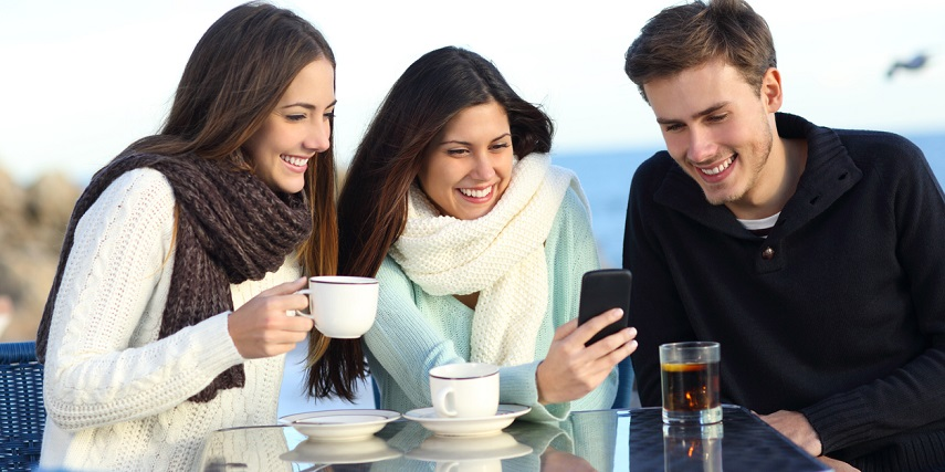 Three friends looking at GIFs developed through augmented reality and eCommerce