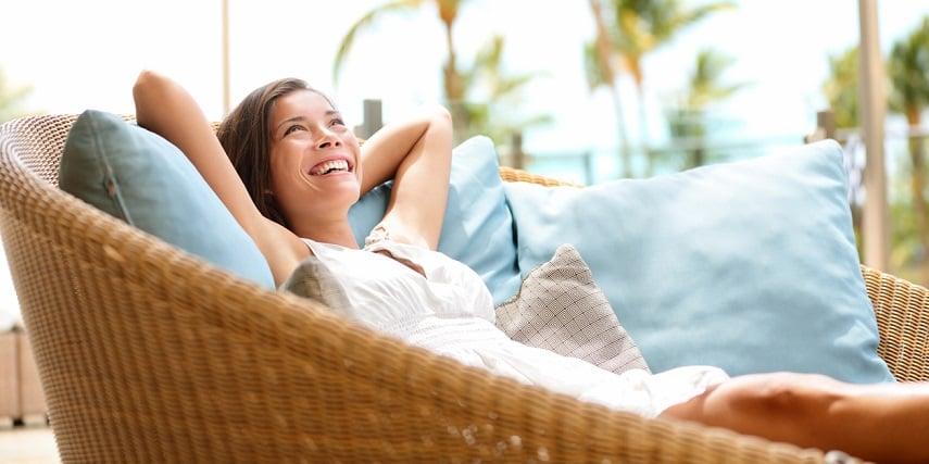 Woman enjoying custom patio furniture made through a 3D furniture configurator