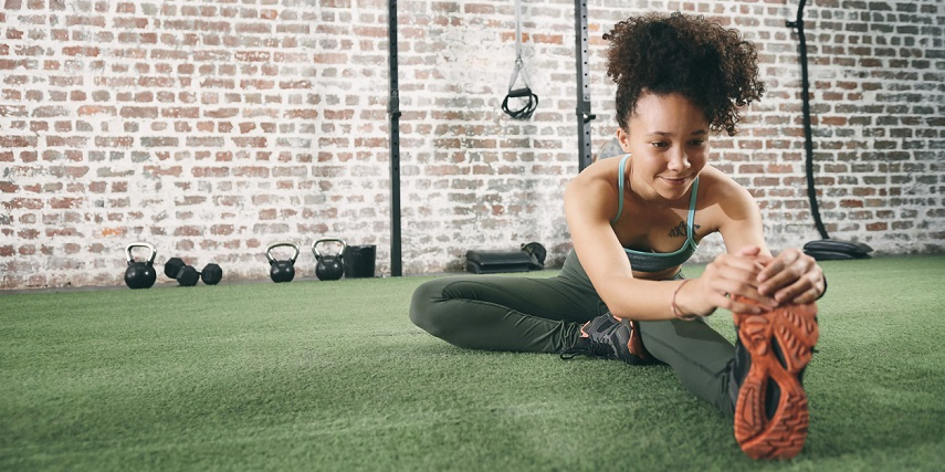 Woman exercising in shoes she designed in a sneaker configurator