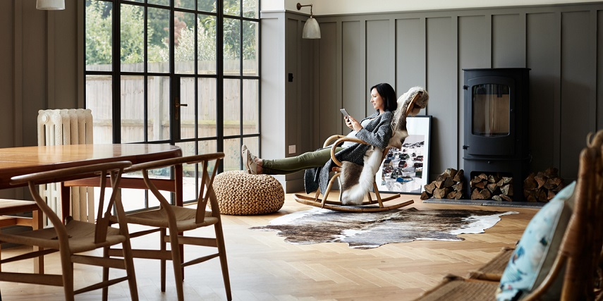 Woman relaxing in a beautifully furnished living room