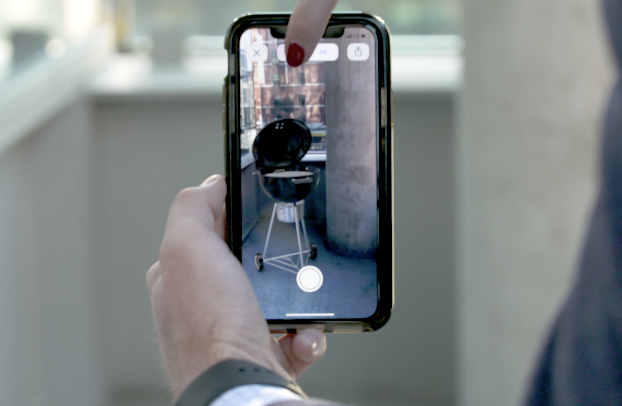 Mobile screen showing AR with finger